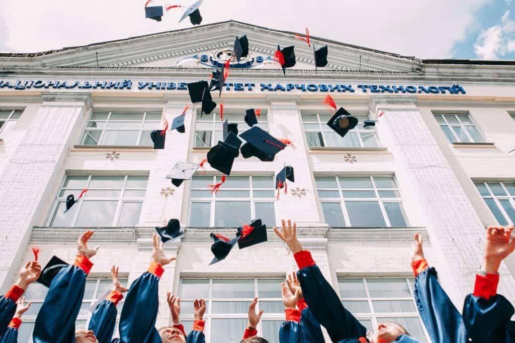 School graduates throwing hats.