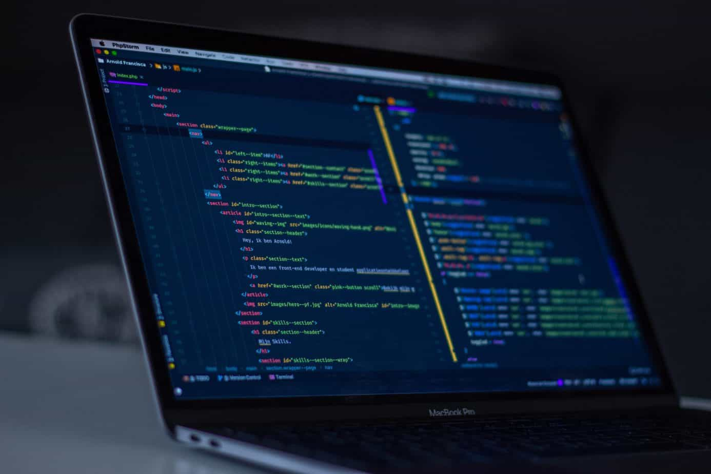 Learn how to become a Web Developer here - picture of a computer screen with code editor.